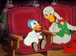 Still from 'She Was An Acrobat's Daughter' featuring the annoying little duck and his father in the cinema