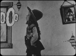 Still from 'Alice's wild west show' featuring Virginia Davis blowing smoke rings