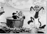 Still from 'Trader Mickey' featuring Mickey playing saxophone to a cannibal